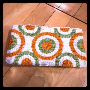 Very pretty orange and green beaded clutch